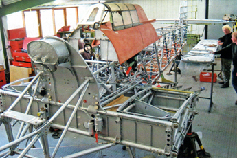 The partly restored Fuselage and Centre Section in March 2007. On the firewall is the coolant header tank.