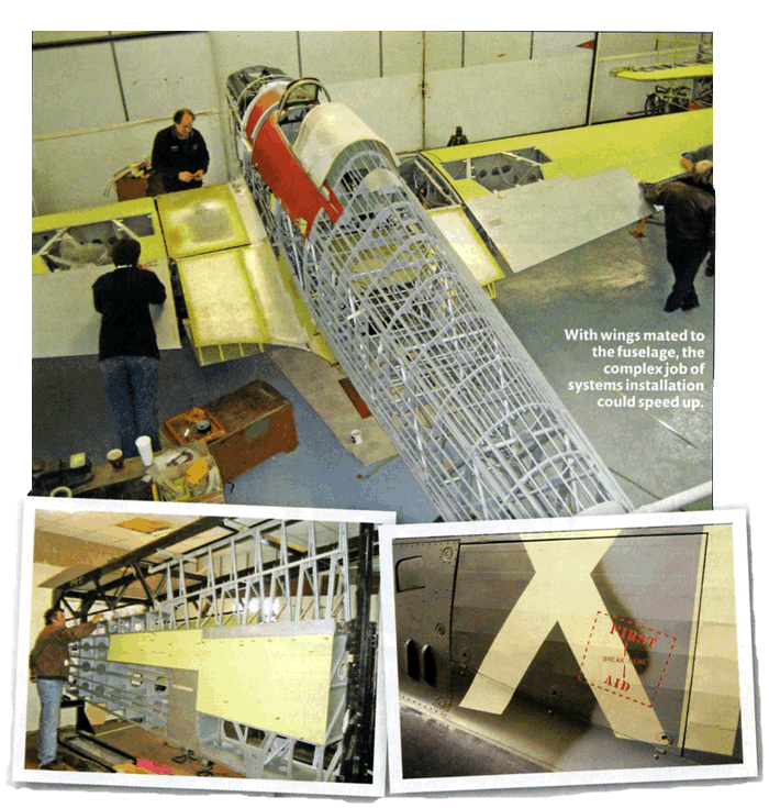 Hangar 11's Chief Engineer Chris Norris examining the port wing as skinning gets under way in March 2008. Detailed stencilling on the fuselage.